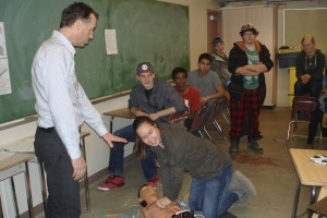 Dr. Holmes Teaching Student CPR on SmartMan